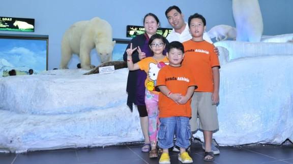 Inge Goreti Ferdiningsih with her family.