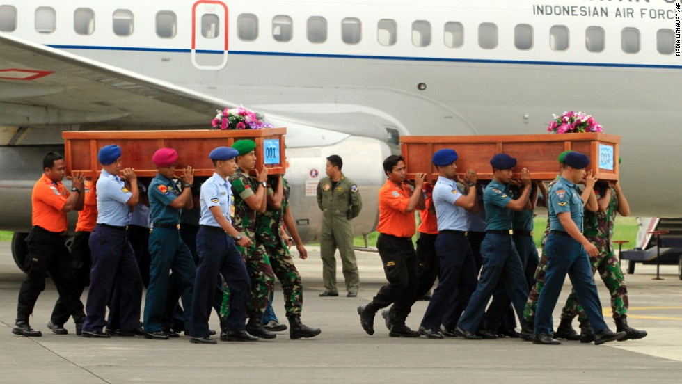 Indonesian soldiers carry coffins of crash victims on December 31.