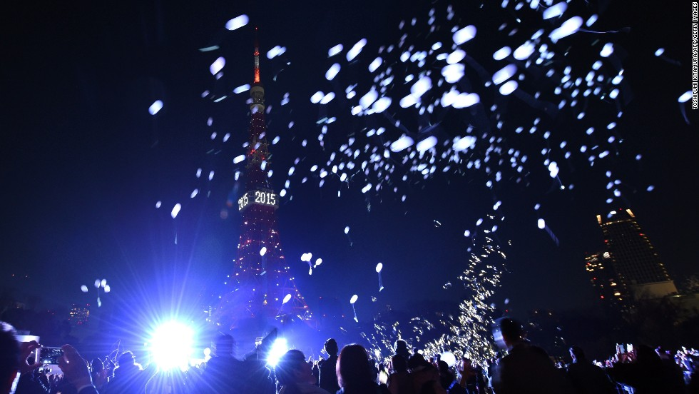 People release balloons beside the Tokyo Tower to celebrate the new year in Japan's capital.