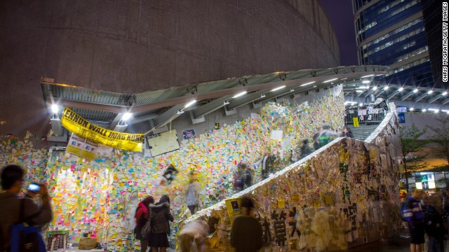 People look at the Lennon Wall outside Hong Kong's Government Complex on December 9, 2014 in Hong Kong.