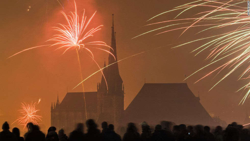 Fireworks light the sky above the medieval St. Mary's Cathedral and St. Severi Church in Erfurt, Germany.