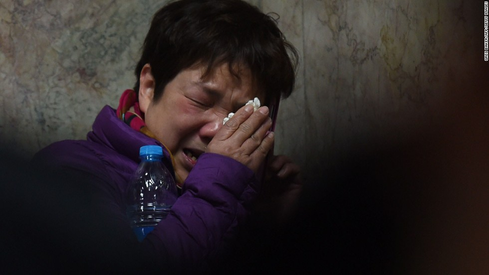 A relative of a victim of the stampede cries as she makes a phone call at a hospital in Shanghai. There were conflicting accounts of what caused the stampede.