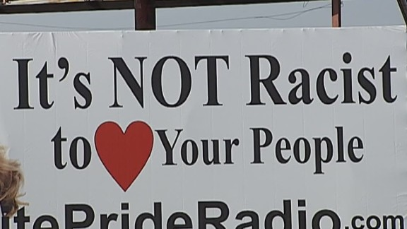 """Uproar broke out when White Pride Radio put up a billboard reading, """"It's NOT racist to love your people"""" in Harrison, Arkansas. Thomas Robb, the national director of Knights of the KKK, said there was no racist intent with the billboard. """"If anybody sees racism in that billboard, then they themselves are racist,"""" Robb told CNN in January."""