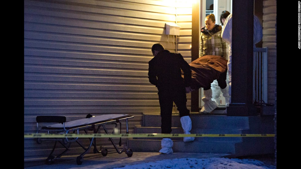 "A body is carried out of a home in Edmonton, Alberta, after what police say was a mass killing Tuesday, December 30. A man described by his family as ""depressed and overly emotional"" <a href=""http://www.cnn.com/2014/12/30/world/americas/edmonton-killings/index.html"" target=""_blank"">is suspected of killing eight people</a> before taking his own life, police said."