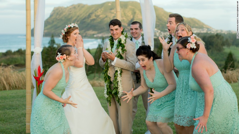 "Natalie Heimel, second from left, and her new husband Edward Mallue Jr. react with their wedding party after President Obama called them Sunday, December 28, in Kaneohe Bay, Hawaii. Obama was calling to apologize to the newlyweds because his golf outing <a href=""http://www.cnn.com/2014/12/29/politics/obama-golf-wedding-hawaii/index.html"" target=""_blank"">forced them to relocate their wedding. </a>"