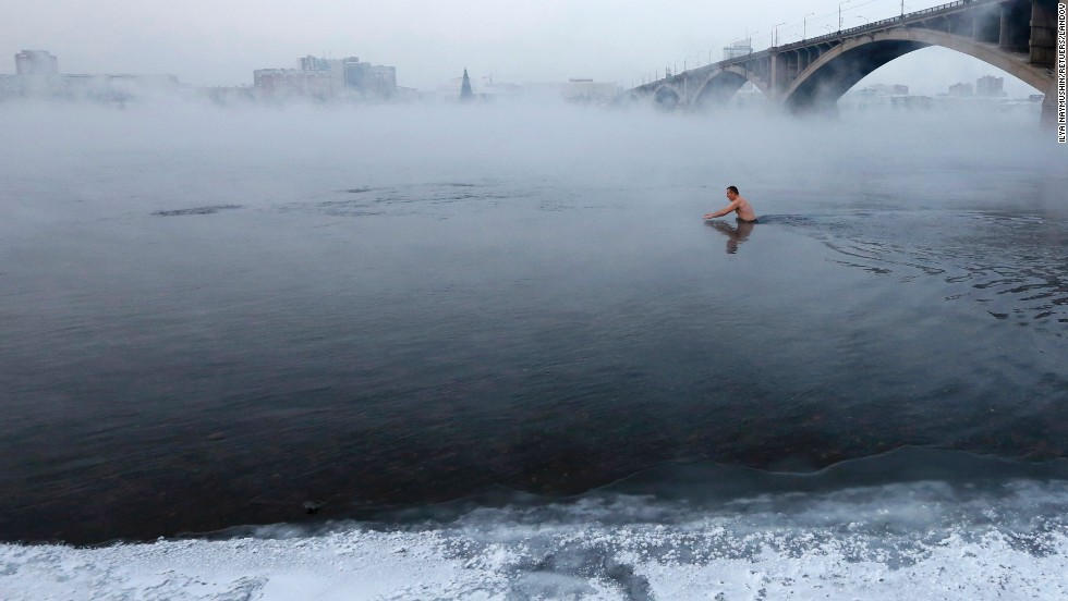 Vladimir Shcherba takes a dip in the Yenisei River in Krasnoyarsk, Russia, on Tuesday, December 30. The air temperature was minus-23 degrees Celsius (minus-9 Fahrenheit).
