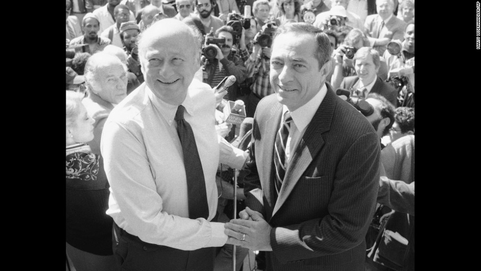 New York Mayor Ed Koch shakes hands with Cuomo on the steps of City Hall in New York on October 7, 1985. Cuomo announced his endorsement of Koch for mayor.