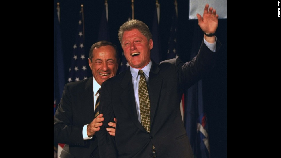 President Bill Clinton waves from the stage with Coumo at the Sheraton New York on October 19, 1994.