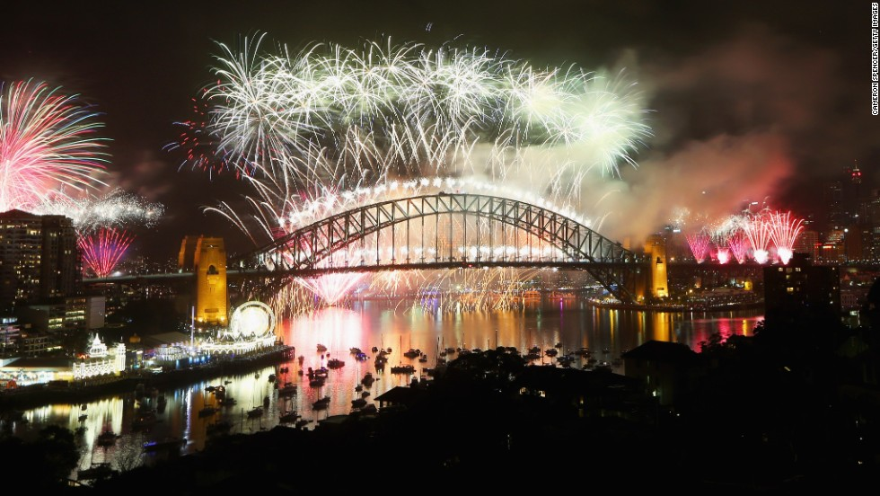 SYDNEY, AUSTRALIA - DECEMBER 31: Fireworks explode off the Sydney Harbour Bridge during the midnight fireworks display on New Year's Eve on Sydney Harbour.