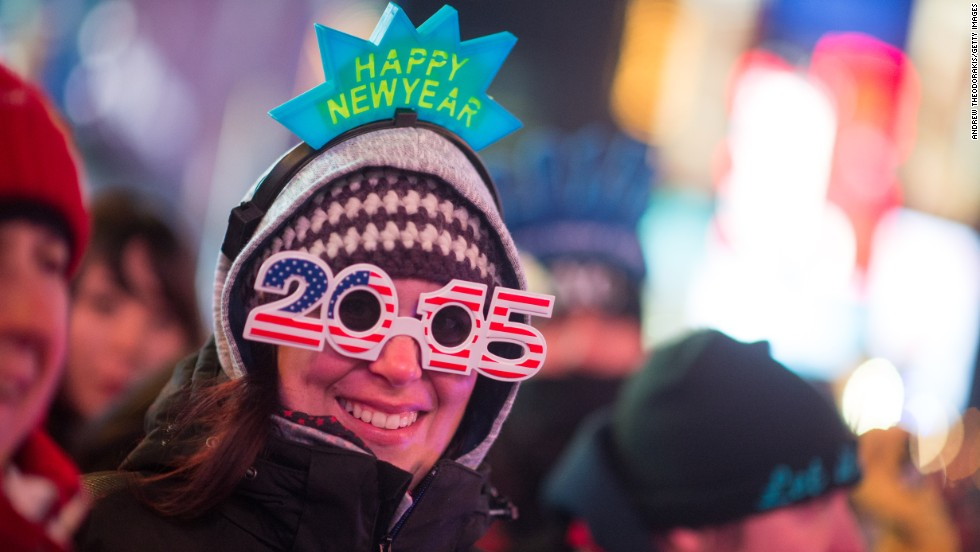 "DECEMBER 31 -- NEW YORK: A reveler celebrates New Year's Eve in Times Square. An estimated one million people from around the world gathered in Times Square to ring in 2015,<a href=""http://edition.cnn.com/video/data/2.0/video/world/2014/12/31/orig-new-years-celebrations-around-the-world.cnn.html""> just one of many major celebrations across the globe</a>."