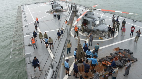Indonesian Navy personnel evacuate dead bodies onboard Navy vessel 'KRI Banda Aceh' during search operations for AirAsia flight QZ8501 in the Java sea on January 3, 2015. Recovery teams have found two big parts of AirAsia Flight 8501, which crashed into the sea last weekend with 162 people on board, Indonesia's top search official said on January 3. AFP PHOTO / POOL / ADEK BERRY (Photo credit should read ADEK BERRY/AFP/Getty Images)