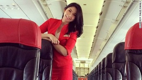 "The body of Khairunisa ""Nisa"" Haidar Fauzi, a flight attendant on  AirAsia Flight QZ8501, was identified in part from her flight uniform and pin."