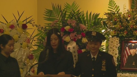 Detective Wenjian Liu's wife gives an emotional goodbye