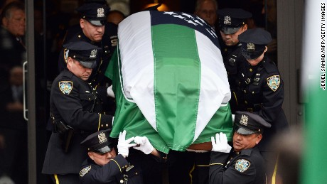 NYPD officers carry the casket of slain officer Wenjian Liu on January 4.