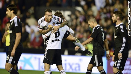 Valencia's Nicolas Otamendi celebrates after scoring against Real Madrid.
