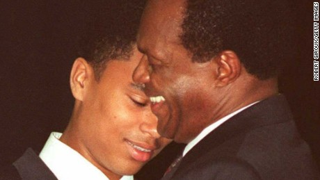 Marion Barry (left) hugs his son Christopher Barry during his fourth inauguration as mayor.