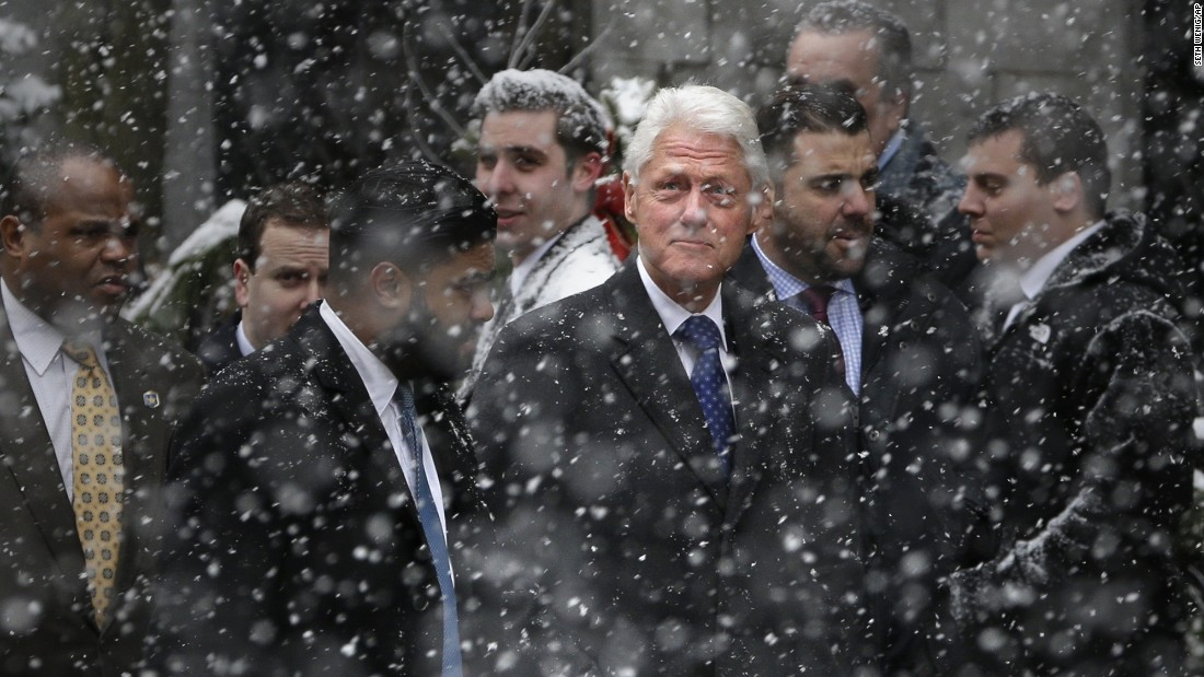 Former President Bill Clinton arrives for the funeral.