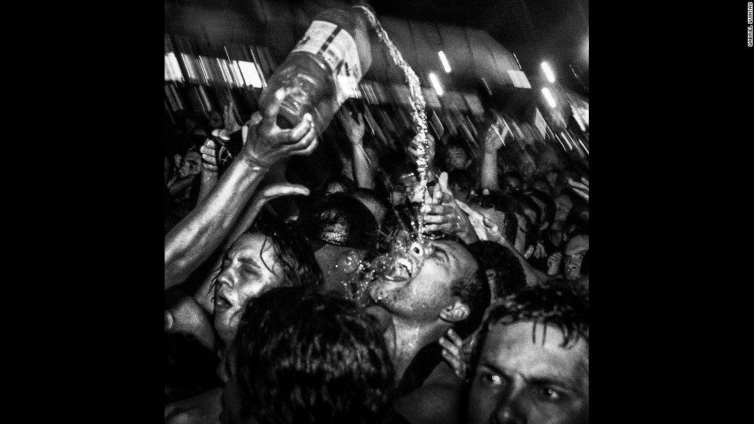 Liquid is poured on a concertgoer at a Pitty performance in 2013.