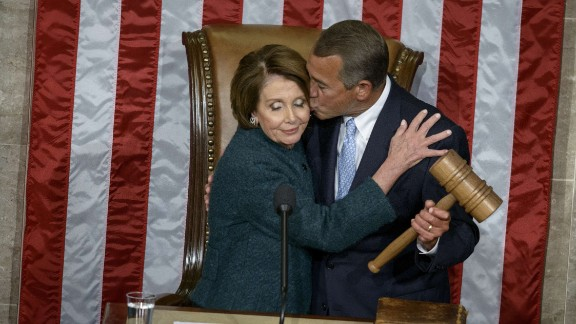 House Minority Leader Nancy Pelosi, D-CA, is kissed as she hands over the gavel to Speaker of the House John Boehner during a swearing-in ceremony in the House of Representatives as the 114th Congress convenes on Capitol Hill January 6.