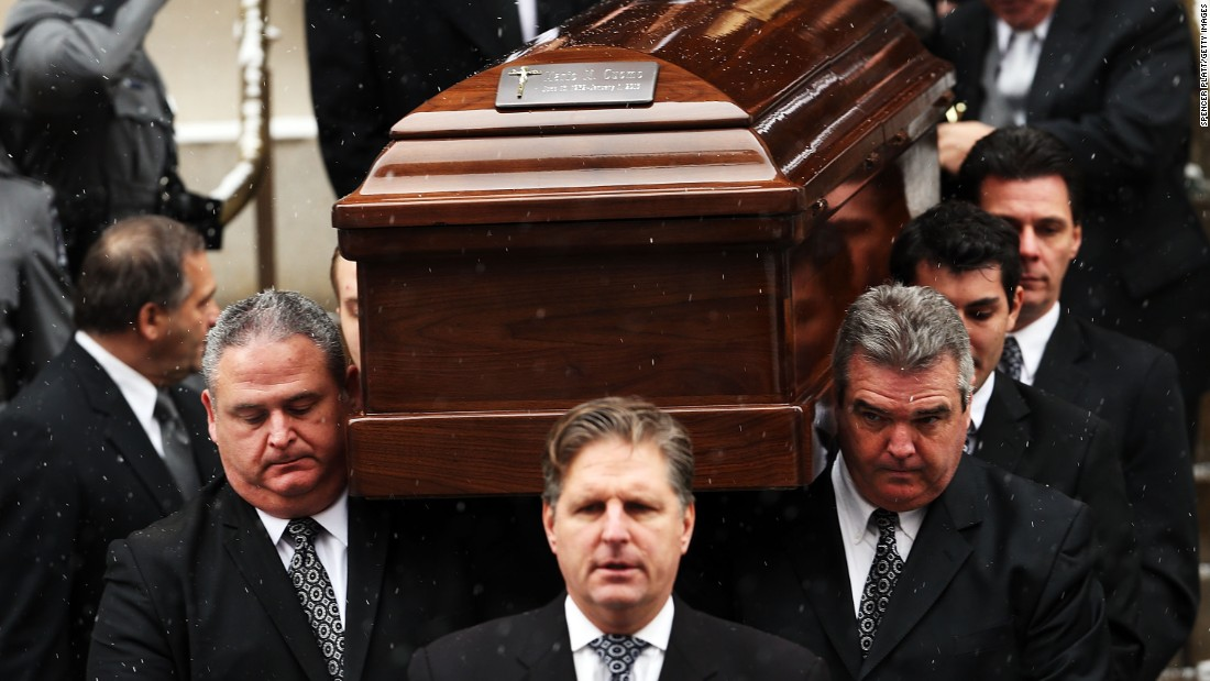 Cuomo's casket is carried from the church.