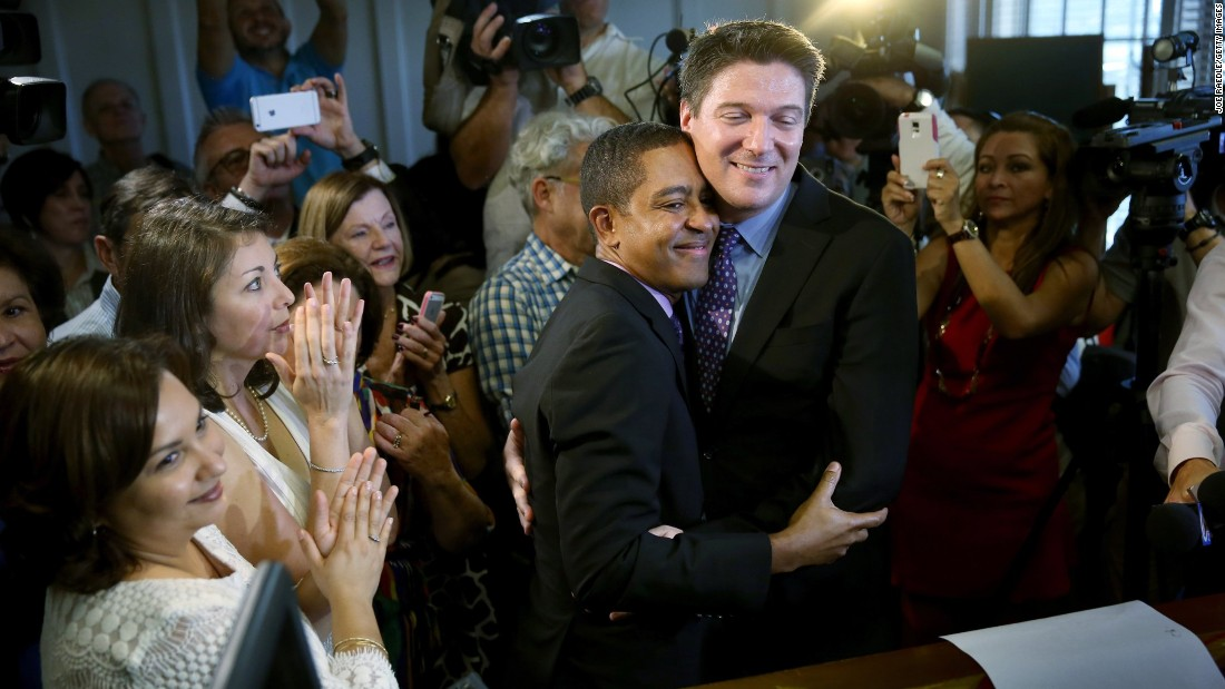 Newlyweds Jeff Delmay and Todd Delmay hug during a marriage ceremony in a Miami courtroom January 5, 2015. Florida began allowing same-sex marriages after a federal judge struck down the state's ban.