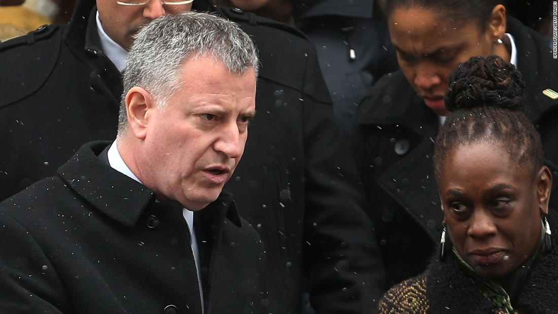 New York Mayor Bill de Blasio leaves the church with his wife, Chirlane McCray.