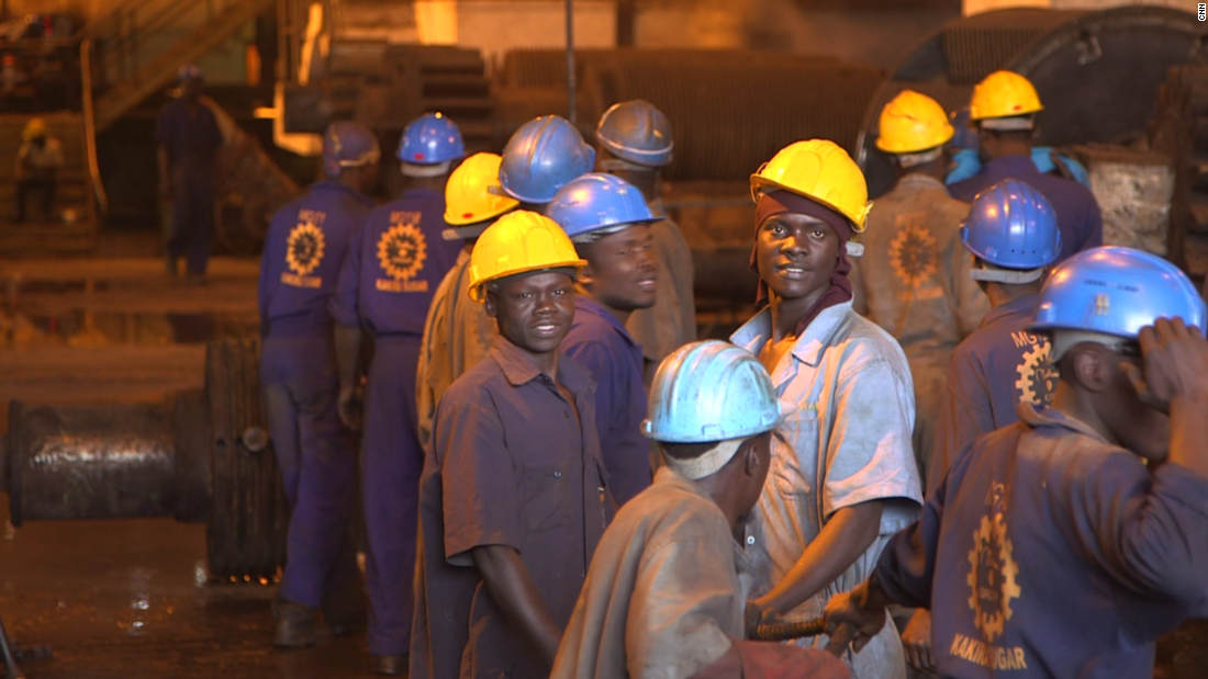 Workers smile for the cameras at the Kakira plant. After Amin was deposed in 1979, the Madhvani family returned to Uganda and looked to piece together their shattered business.
