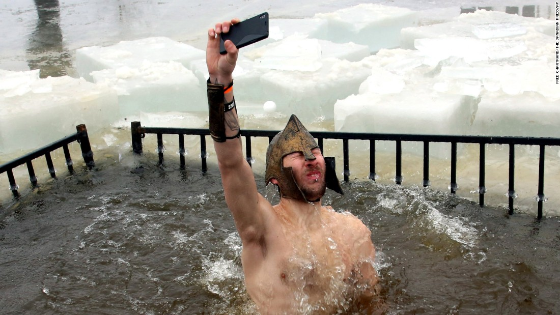 A man snaps a selfie as he takes part in the New Year's Day polar bear dip in Ottawa on Thursday, January 1. The event raised money to help fight pediatric cancer.