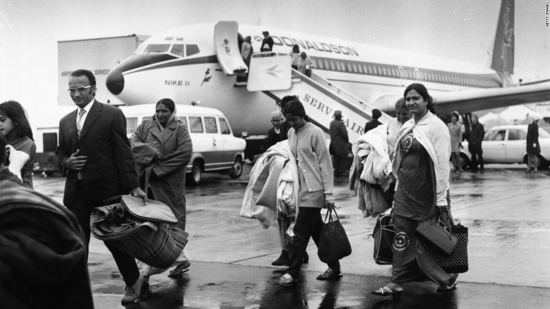Indian refugees land at Stansted Airport near London after being airlifted out of Uganda.