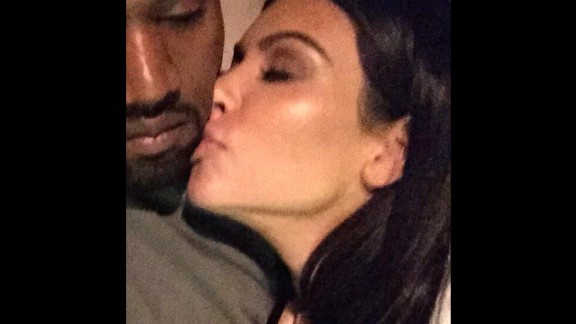"""Television personality Kim Kardashian kisses her husband, rapper Kanye West, in this selfie <a href=""""https://twitter.com/KimKardashian/status/551264115411279872/photo/1"""" target=""""_blank"""" target=""""_blank"""">she tweeted</a> Friday, January 2. """"Good night,"""" she wrote."""
