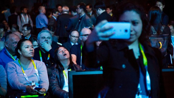 A woman takes a selfie as she and others wait for a Samsung news conference to begin Monday, January 5, at the Consumer Electronics Show in Las Vegas.