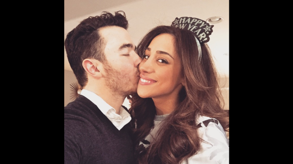 """Singer Kevin Jonas smooches his wife, Danielle, on Thursday, January 1. """"New year same love and it's perfect,"""" <a href=""""http://instagram.com/p/xTUqzaj-WU/?modal=true"""" target=""""_blank"""" target=""""_blank"""">he said on Instagram.</a>"""