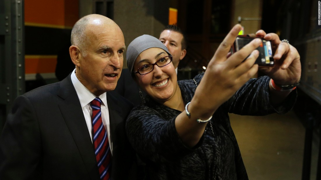 California Gov. Jerry Brown poses for a selfie at a reception held in his honor Monday, January 5, at the California State Railroad Museum in Sacramento, California. Earlier in the day, Brown was sworn in for his fourth term.