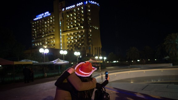 """A couple in Baghdad, Iraq, takes a selfie to celebrate the new year on Thursday, January 1. <a href=""""http://www.cnn.com/2014/12/31/living/gallery/look-at-me-selfies-1231/index.html"""" target=""""_blank"""">See 23 selfies from last week</a>"""