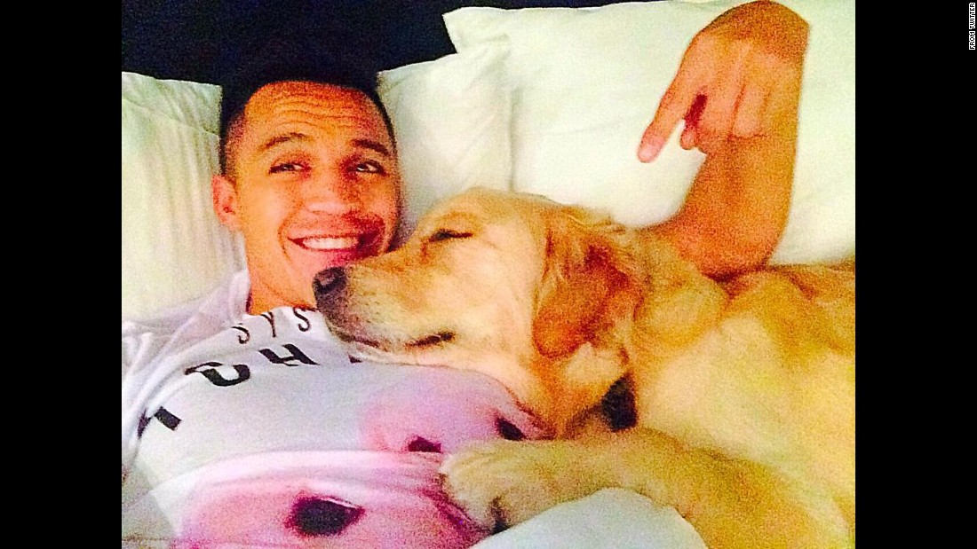 "Arsenal soccer star Alexis Sanchez gets cozy with his dog in this selfie <a href=""https://twitter.com/Alexis_Sanchez/status/551156528062156801/photo/1"" target=""_blank"">he tweeted</a> Friday, January 2."