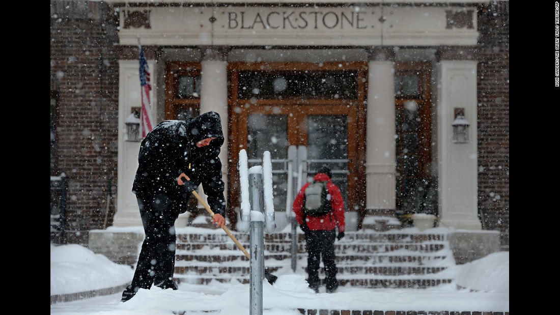 Cody Charboneau shovels the walkway in Great Falls, Montana, during a winter storm Monday, January 5.