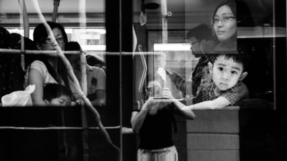 Bacani catches her reflection on a bus in Causeway Bay, one of Hong Kong