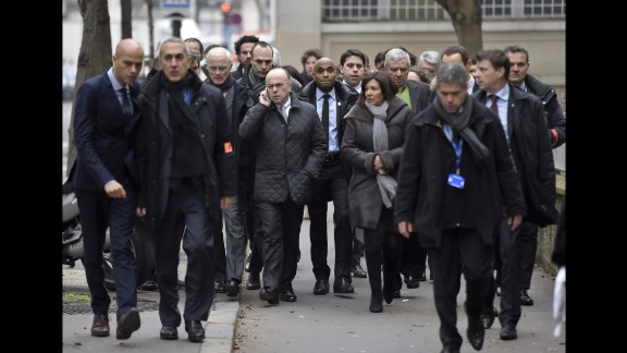 Paris Mayor Anne Hidalgo and Interior Minister Bernard Cazeneuve arrive at the scene.