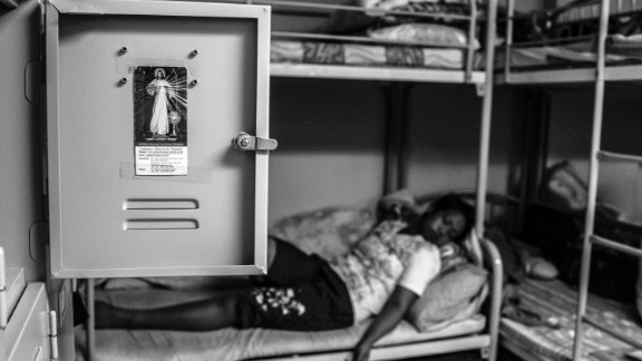 Thousands of migrant workers work silently and invisibly in Hong Kong homes. Kuryati, a migrant worker from Indonesia, was accused of stealing. She rests after a stressful court hearing.