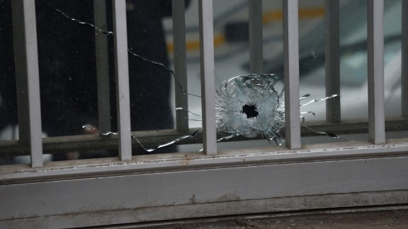 A bullet hole is seen in a window of the magazine