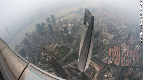 Caption:A general view shows the Shanghai World Financial Center and the skyline of the Lujiazui Financial District in Pudong, seen from the 109th floor of the Shanghai Tower (still under construction), covered in smog in Shanghai on October 16, 2014. China has for years been hit by heavy air pollution, caused by enormous use of coal to generate electricity to power a booming economy, and more vehicles on the roads. AFP PHOTO / JOHANNES EISELE (Photo credit should read JOHANNES EISELE/AFP/Getty Images)