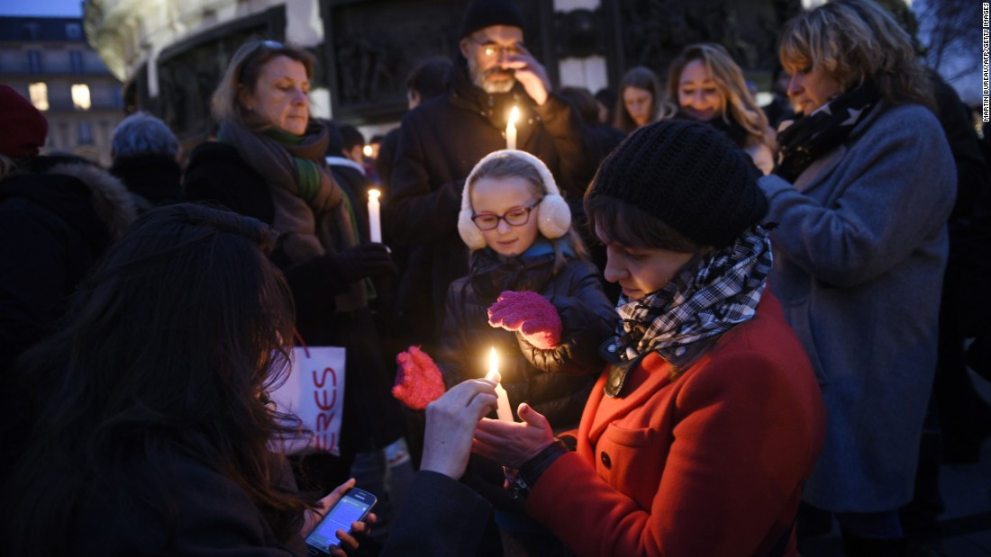 People light candles at the Place de la Republique on January 7.