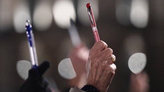 People hold up pens as a show of support in Rennes on January 7.