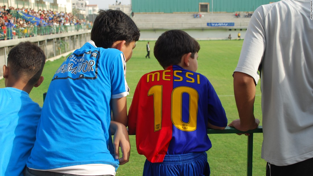 Palestinian kids are riveted by their favorite up and coming football players.