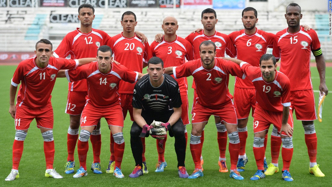 The Palestinian team poses for photos prior to their knock-out game of the Peace Cup invitational tournament in Manila on September 3, 2014.