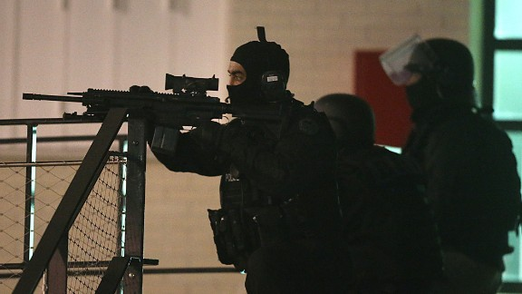 Sharpshooters are seen outside during the operation in Reims.