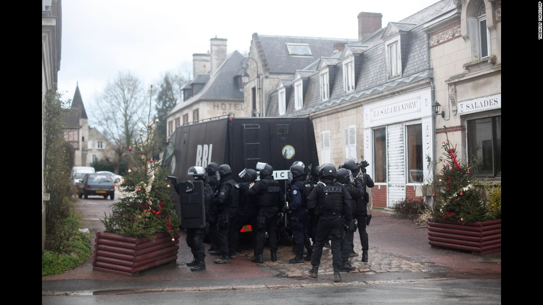 French police officers gather January 8 in Longpont, France, about 10 kilometers (6.2 miles) from where the suspects were reportedly spotted.