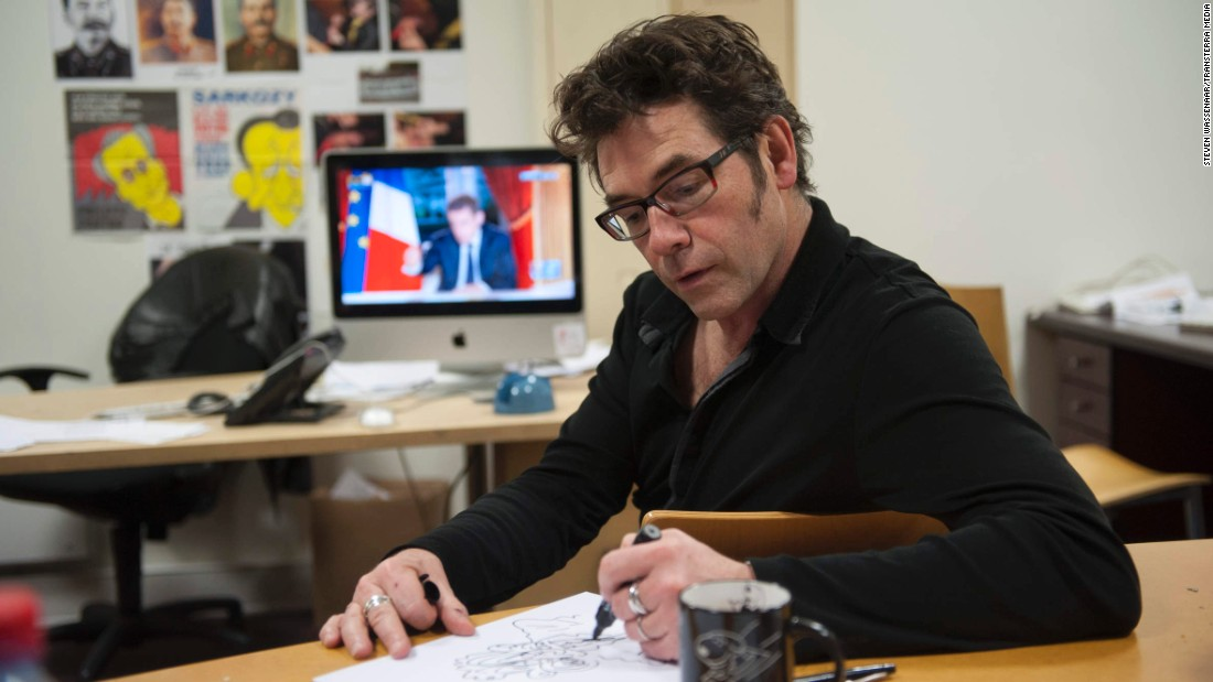 "Another one of the shooting victims, cartoonist Bernard ""Tignous"" Verlhac, sketches a political cartoon in 2012."
