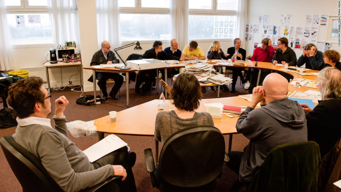 Charlie Hebdo staff attend an editorial meeting in 2012.