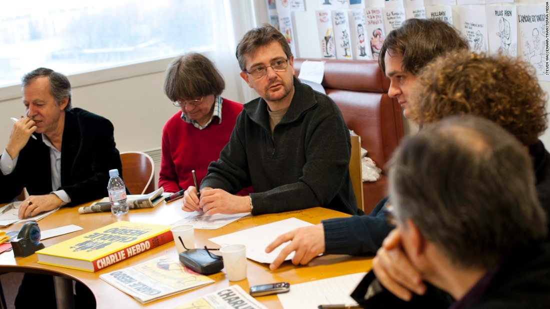 Bernard Maris, far left, is a columnist who served as the magazine's deputy editor. To his immediate left are Cabut and Charbonnier. All three men were killed in the terror attack.